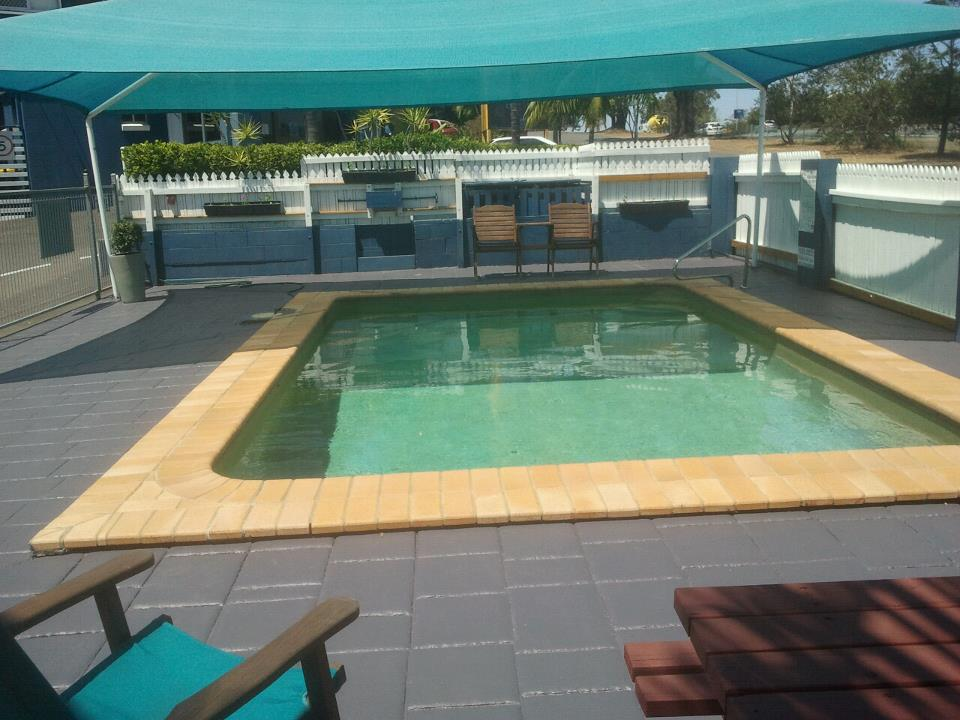 Relax by the pool and BBQ area at Aspley Motor Inn